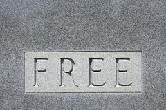 The word Free on stone. Stock Images