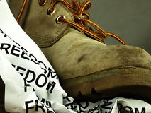 The word freedom crushed by a heavy, old military boot. Royalty Free Stock Photo