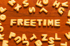 The word freetime written with cracker Royalty Free Stock Image