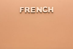 Word French on beige background Royalty Free Stock Photos