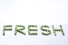 Word fresh created from peas Stock Photo