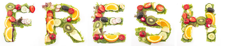 Word fresh made of salad and fruits Royalty Free Stock Images