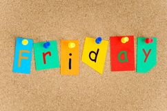 Finally Friday, Conceptual Notice Board. Word Friday Printed on Colourful Pieces of Paper on Notice Board Stock Photography