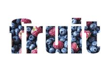 Word FRUIT composed of different fruits and berries. Black-blue and red food. Ripe blueberries and raspberries. Top view royalty free stock image