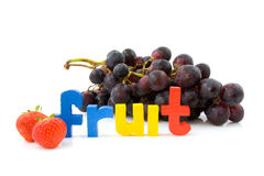 Word Fruit with grapes and strawberry Stock Photos