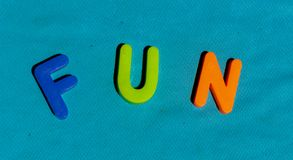The word Fun composed from letters. The word Fun composed from colorful children toy big letters on the grass royalty free stock photos