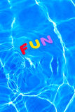 Word FUN floating in a swimming pool Royalty Free Stock Photography