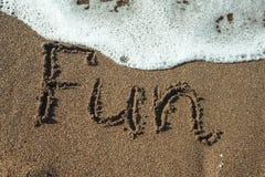 Word fun written in sand. Stock Image