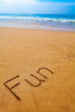 Word Fun Written in Sand on Tropical Beach Stock Image