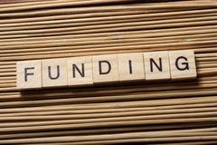 FUNDING word written on wooden cubes. Finance Concept. Money