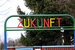 The word future. Colorful letters made of metal on a gate in german Royalty Free Stock Photography