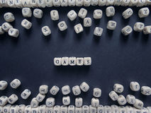 Word Games of small white cubes next to a bunch of other letters Stock Photo