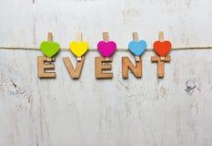 Word gebeurtenis van houten brieven op een witte houten achtergrond Stock Afbeelding