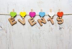 Word gebeurtenissen van houten brieven op een witte houten achtergrond Royalty-vrije Stock Afbeelding