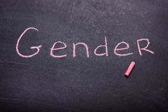 The word gender is written chalk. On the blackboard royalty free stock photography