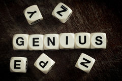 Word genius on toy cubes. Word genius on white toy cubes royalty free stock photos