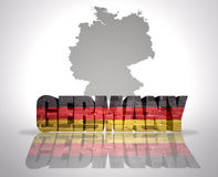 Word Germany on a map background. Word Germany with National Flag near map of Germany stock photography