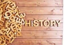 Word geschiedenis met houten brieven wordt gemaakt die stock afbeelding