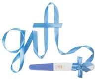 Word gift written ribbon. Positive pregnancy test Stock Photos