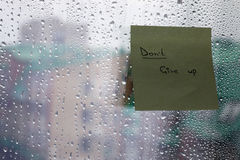 Word on the glass with drops Royalty Free Stock Photo