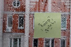 Word on the glass with drops. Word on the glass with water drops on a glass in rainy day Stock Photo