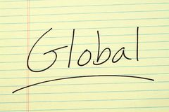 Global On A Yellow Legal Pad. The word `Global` underlined on a yellow legal pad Stock Photography