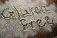 The word gluten free written on sprinkled flour