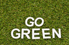 Word go green made from wood on artificial grass Royalty Free Stock Photo