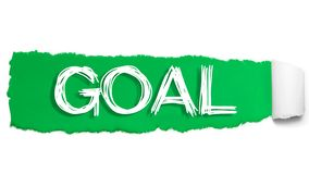 The word GOAL appearing behind green torn paper stock photo
