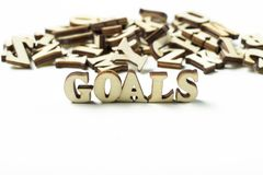 The word goal written in wooden letters, the concept of setting goals royalty free stock photos