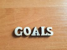The word `goals` made of wooden letters stock image