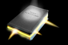 The word of god is alive. Concept photo of holy bible with divine spiritual light emanating from the pages depicting word of god alive theme Stock Images
