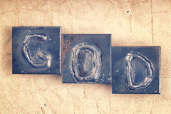The word GOD made from metal letters Royalty Free Stock Photo