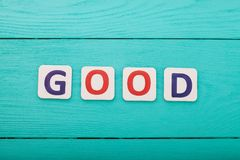 Word good on blue wooden background. Copy space. Top view. Mock up. Business success concept stock photos