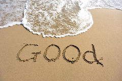 Word good drawn on the beach Royalty Free Stock Image