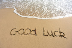 Word good luck drawn on the beach Stock Image