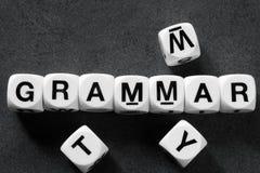 Word grammatica op stuk speelgoed kubussen stock foto