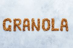 Word granola written with roasted oats and nuts granola royalty free stock image