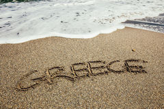The word Greece written in the sand Royalty Free Stock Photo