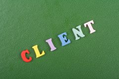 CLIENT word on green background composed from colorful abc alphabet block wooden letters, copy space for ad text stock photography