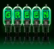 Word GREEN made with bulbs with glowing letters Stock Images