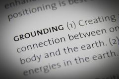 The word Grounding close up on paper.  Stock Photo