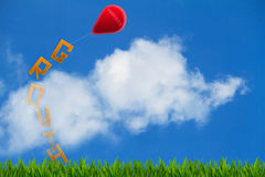 The word growth on grass tied up to red balloon with word targets on cloudy blue sky background. Business goal concept Stock Image