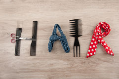 Word hair consist of hairdressing accessories Royalty Free Stock Photography
