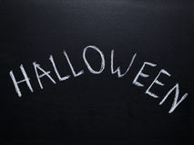 Word halloween handwritten on chalkboard Royalty Free Stock Photo