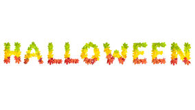 Word HALLOWEEN made of autumn maple leaves in bright colors Royalty Free Stock Photography