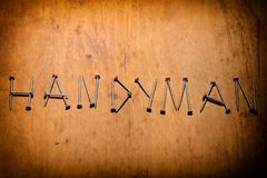 The word `Handyman` is represented by screws Royalty Free Stock Photo