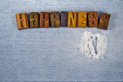 Word happiness in wood letterpress type Stock Photo