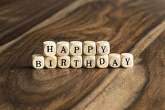 Word HAPPY BIRTHDAY on wooden cubes Stock Photography