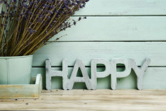 Word happy and bunch of lavender flowers Royalty Free Stock Photo